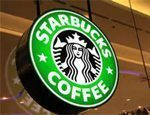 Starbucks to move European base to London, pay more UK tax